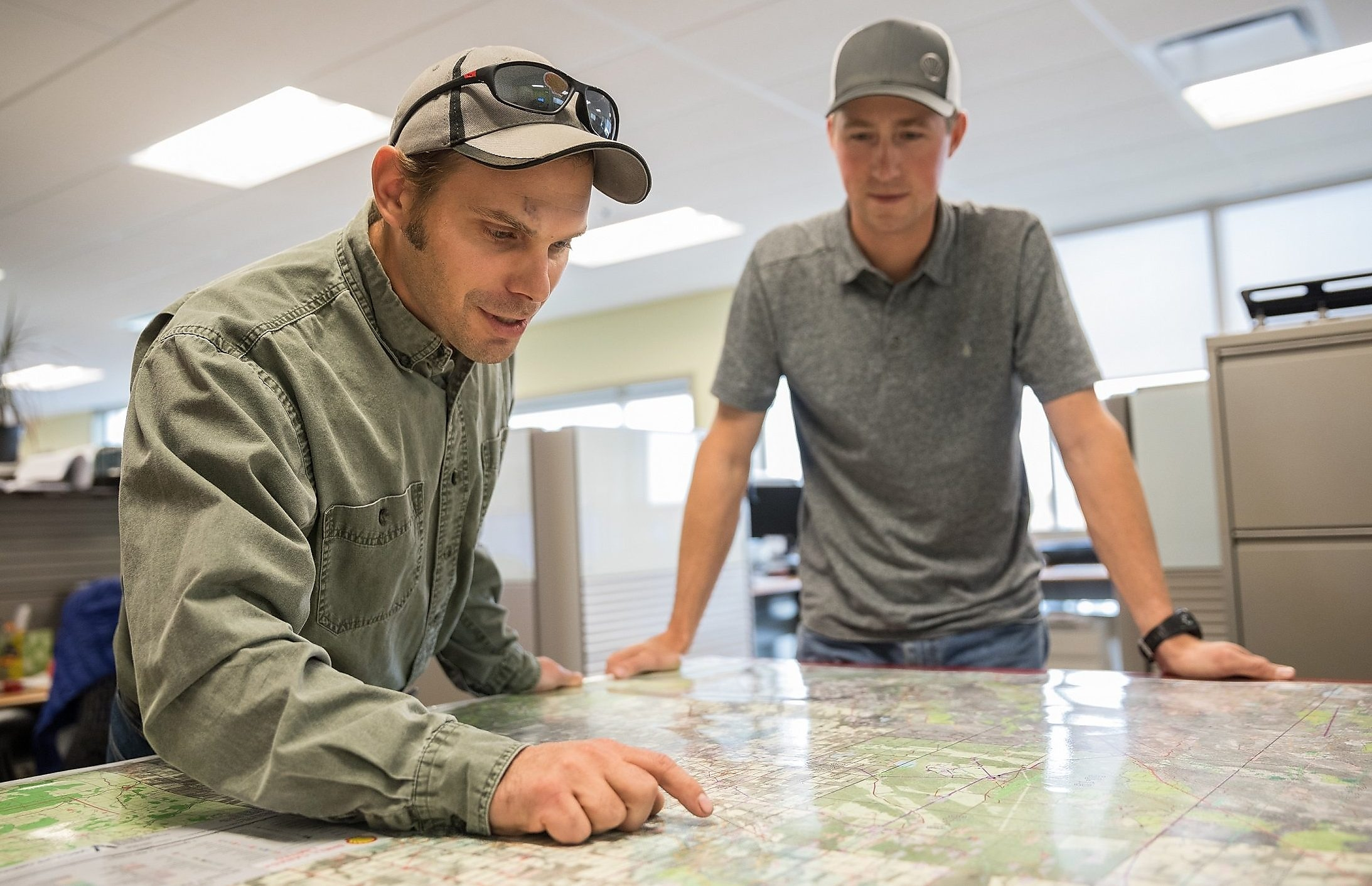 Shell employees consult a map of Groundbirch operations
