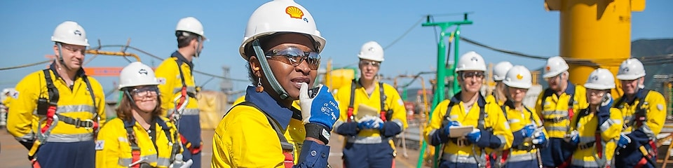 A female Shell engineer leading her team at an operational site.