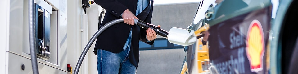 man pumping fuel