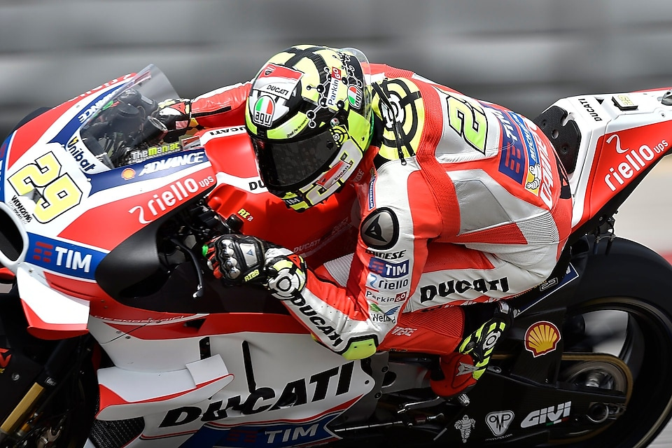 Ducati rider on superbike leaning into a corner whilst racing