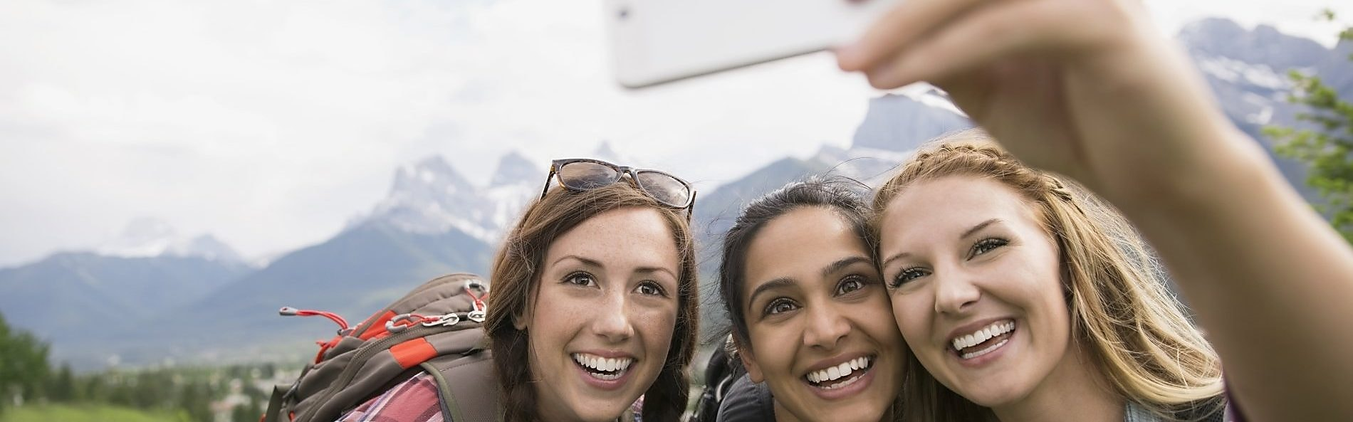 three girls taking selfie while on adventure