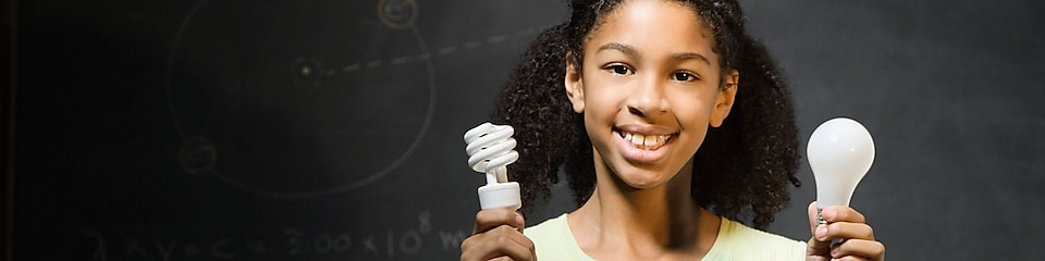 girl holding light bulbs